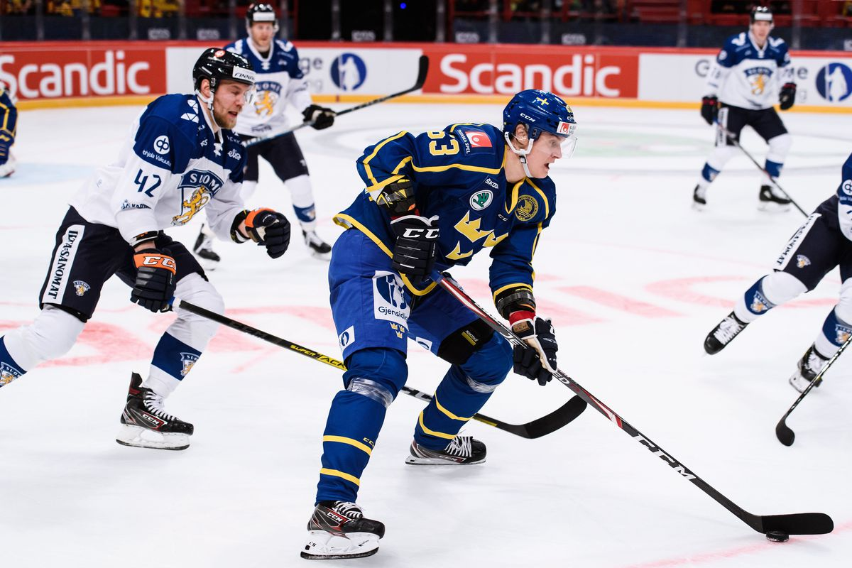 Sweden's Fredrik Handemark vies with Finland's Ilari Melart (L) during Beijer Hockey Games between Sweden and Finland at the Ericson Globe Arena in Stockholm, Sweden, on February 09, 2020.