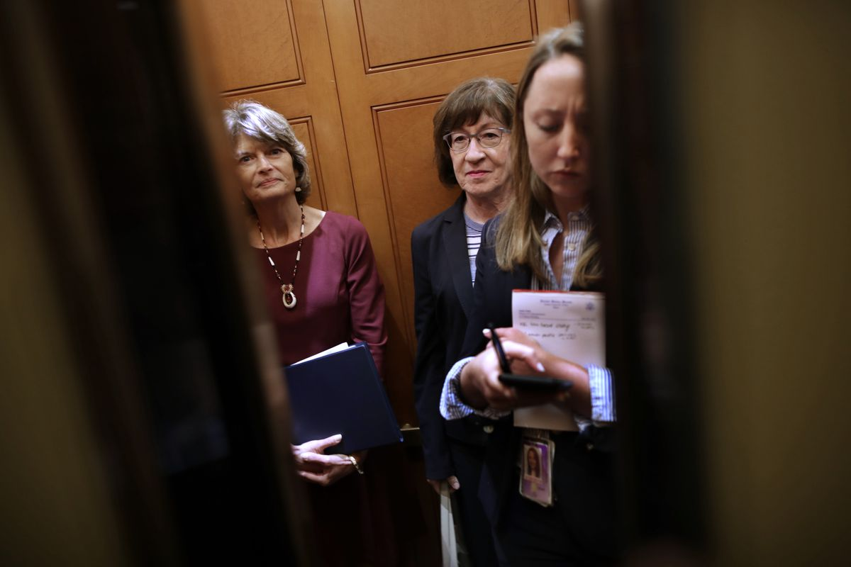 Sen. Lisa Murkowski (R-AK) (L) and Sen. Susan Collins (R-ME) share an elevator as they head for the weekly Senate Republican policy luncheon at the U.S. Capitol October 02, 2018 in Washington, DC. Senate GOP leaders agreed last week with the Judiciary Com
