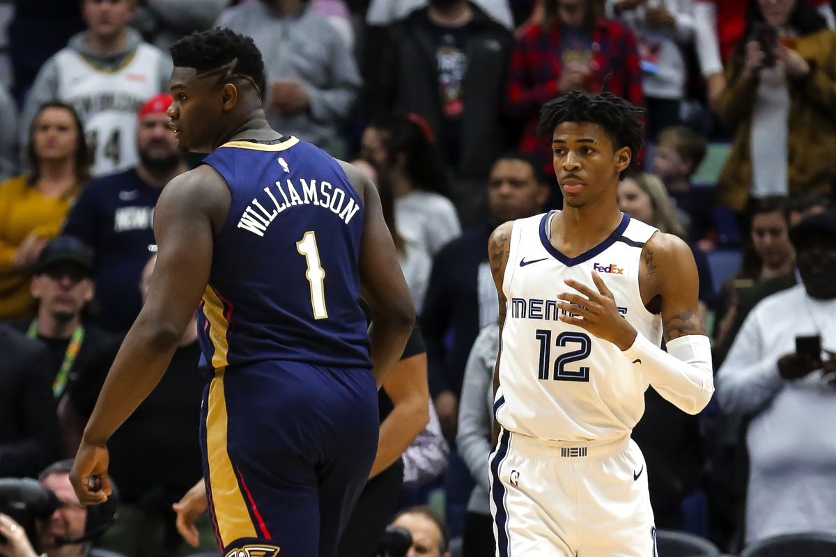 New Orleans Pelicans forward Zion Williamson and Memphis Grizzlies guard Ja Morant during the first quarter at the Smoothie King Center.