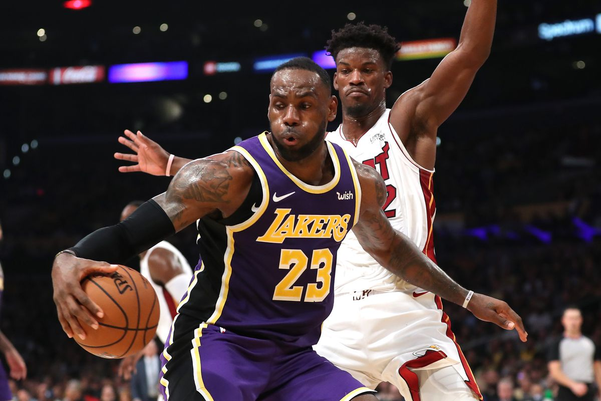 Jimmy Butler of the Miami Heat defends against LeBron James of the Los Angeles Lakers during the second half of a game at Staples Center on November 08, 2019 in Los Angeles, California.