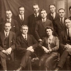 A group of LDS missionaries serving in the British mission in 1922. Ezra Taft Benson, a future president of the church, is seated on far right. President David O. McKay and his wife are seated in the center.