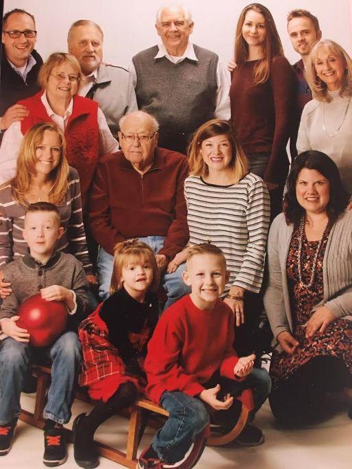 Bill Davis (center, maroon shirt) with his family. | Provided photo