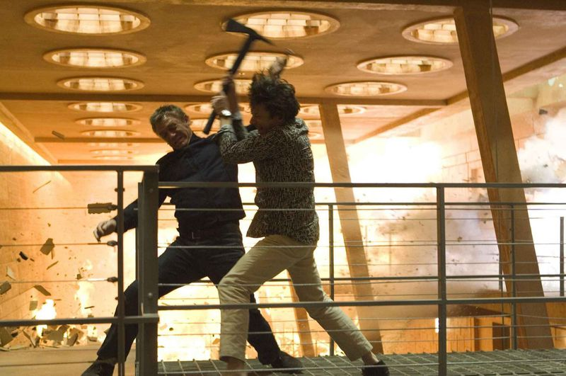 Bond fights the Quantum of Solace boss in a burning building