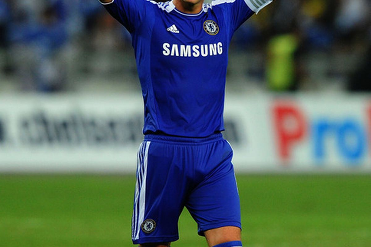 Good of the captain to wave bye-bye to Chelsea's title hopes.  (Photo by Stanley Chou/Getty Images)