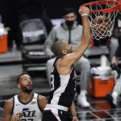 Los Angeles Clippers forward Nicolas Batum, right, dunks as Utah Jazz center Rudy Gobert watches during the second half of Game 3 of a second-round NBA basketball playoff series Saturday, June 12, 2021, in Los Angeles.