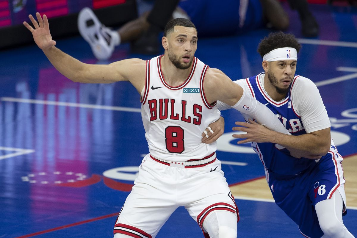 Zach LaVine of the Chicago Bulls battles for position against Seth Curry of the Philadelphia 76ers at Wells Fargo Center on February 19, 2021 in Philadelphia, Pennsylvania. The 76ers defeated the Bulls 112-105.