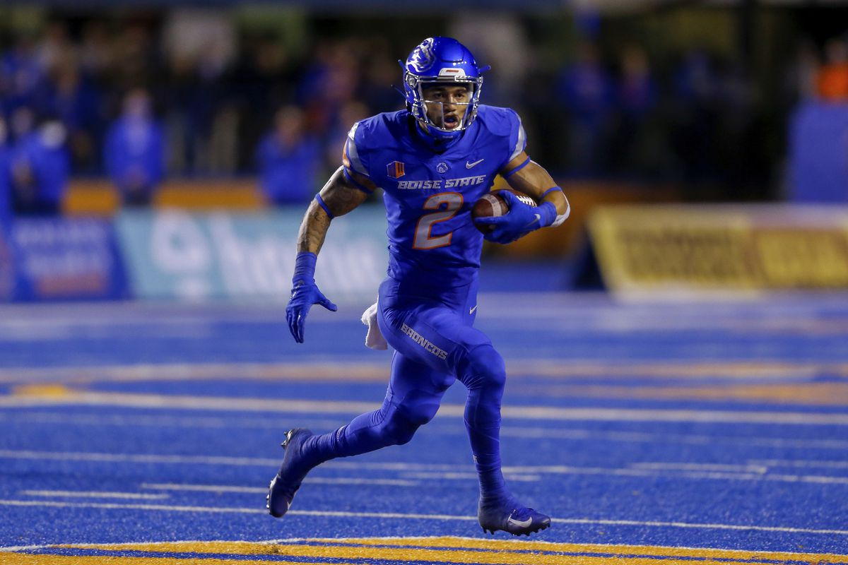 Boise State wide receiver Khalil Shakir (2) runs with the ball against Oklahoma State