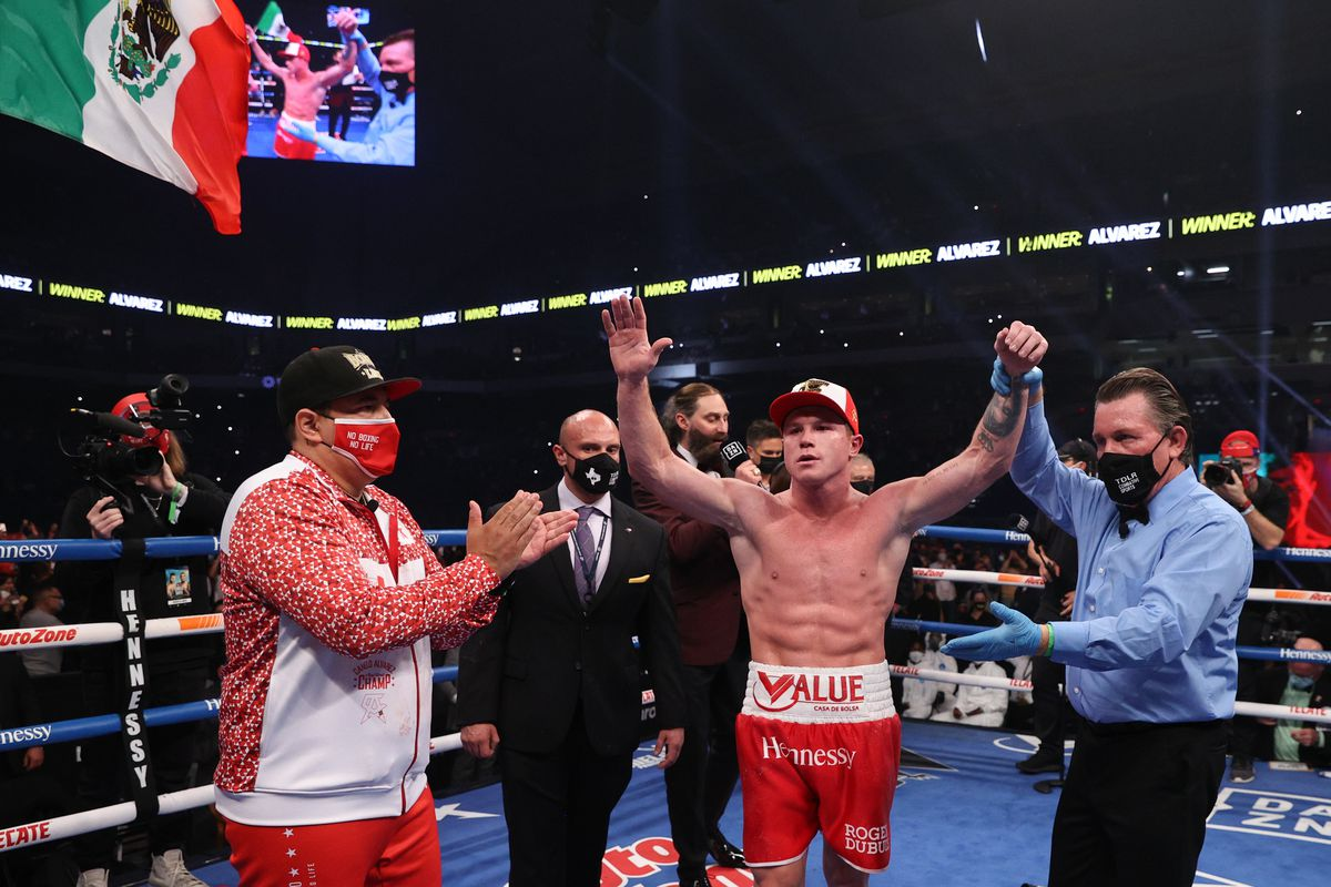 Canelo Alvarez (red trunks) celebrates after defeating Callum Smith (white trunks) during their WBA, WBC and Ring Magazine super middleweight championship bout at the Alamodome in San Antonio, TX.