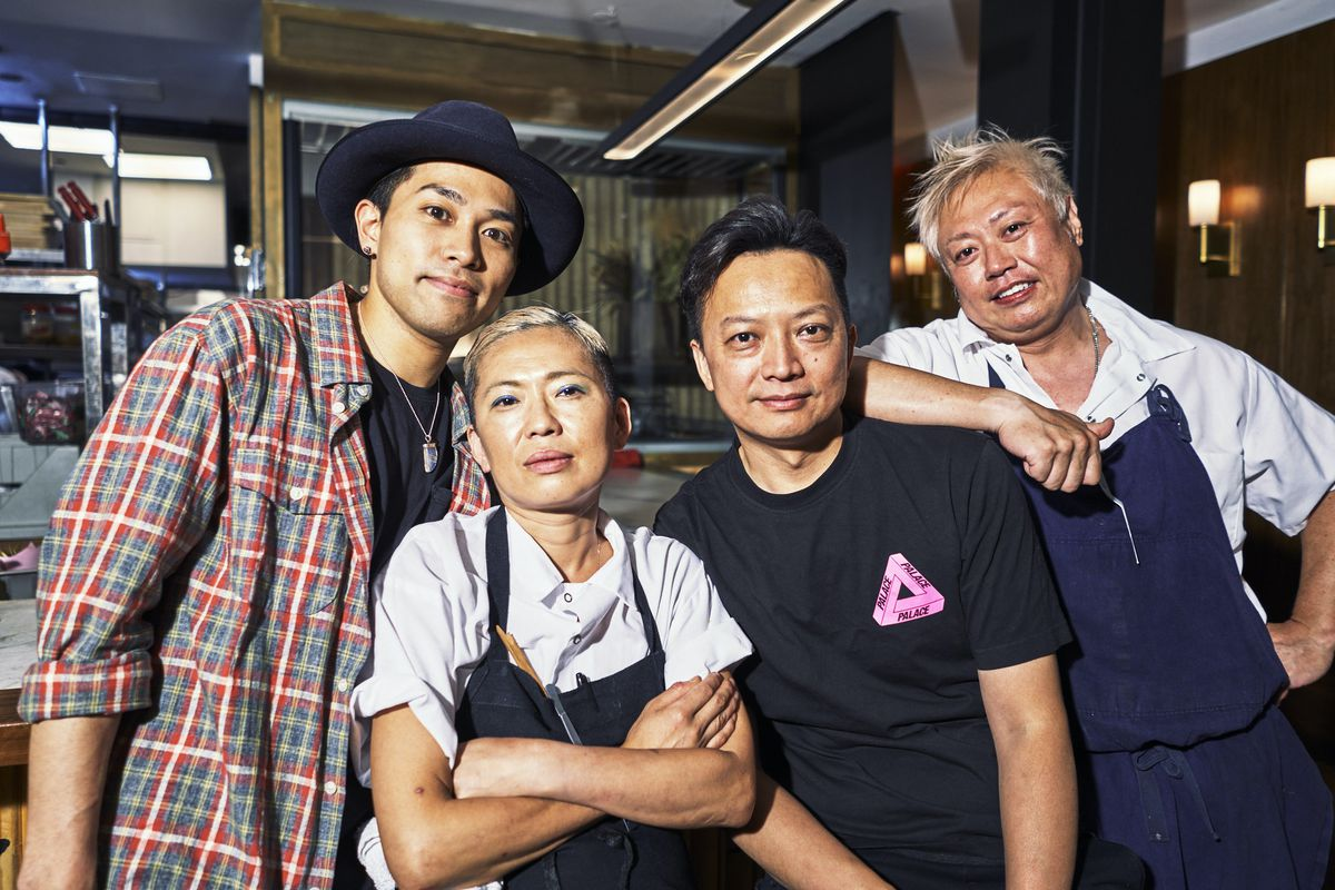 Four restaurant workers pose in a Chinatown restaurant.
