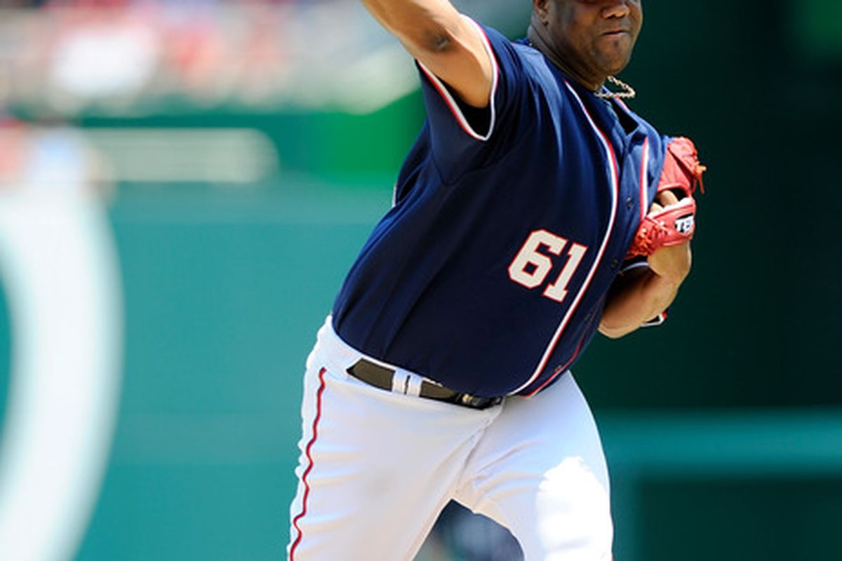 WASHINGTON, DC - MAY 30:  Livan Hernandez #61 of the Washington Nationals pitches against the Philadelphia Phillies at Nationals Park on May 30, 2011 in Washington, DC.  (Photo by Greg Fiume/Getty Images)