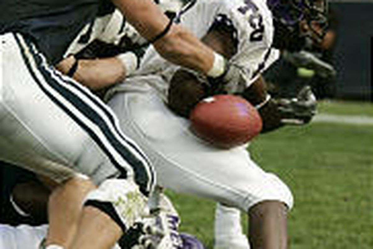 TCU's Cory Rodgers loses the ball near the goal line in overtime. Officials ruled Rodgers scored prior to dropping the ball, and the subsequent extra point won the game.