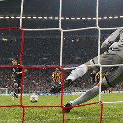 Valencia's goalkeeper Diego Alves of Brazil saves a penalty of Bayern's Mario Mandzukic of Croatia during the Champions League Group F soccer match between FC Bayern Munich and Valencia CF in Munich, southern Germany, Wednesday, Sept. 19, 2012.