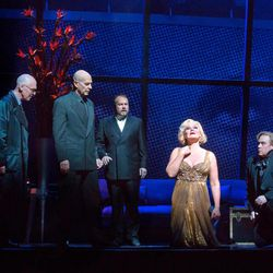 """In this April 20, 2012, photo provided by the Metropolitan Opera, Karita Mattila plays the 337-year-old Emilia Marty in Janacek's """"The Makropulos Case"""" during a rehearsal at the Metropolitan Opera in New York.  With Mattila are, from left, Alan Oke as Vitek, Tom Fox as Dr. Kolenaty, Johan Reuter as Jaroslav Prus. """"The Makropulos Case"""" during a rehearsal at the Metropolitan Opera in New York. """"The Makropulos Case"""" returned to the Met on Friday night, April 27, after an 11-year absence."""