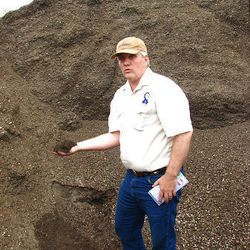 Floyd Faucette of Miller LC with materials used to manufacture soil mixes.