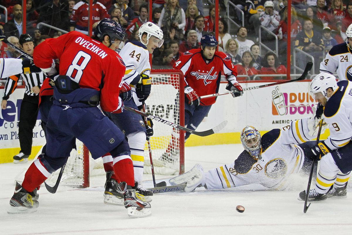 March 27, 2012; Washington, DC, USA; Buffalo Sabres goalie Ryan Miller (30) makes a save on Washington Capitals left wing Alex Ovechkin (8) in the second period at Verizon Center. Mandatory Credit: Geoff Burke-US PRESSWIRE