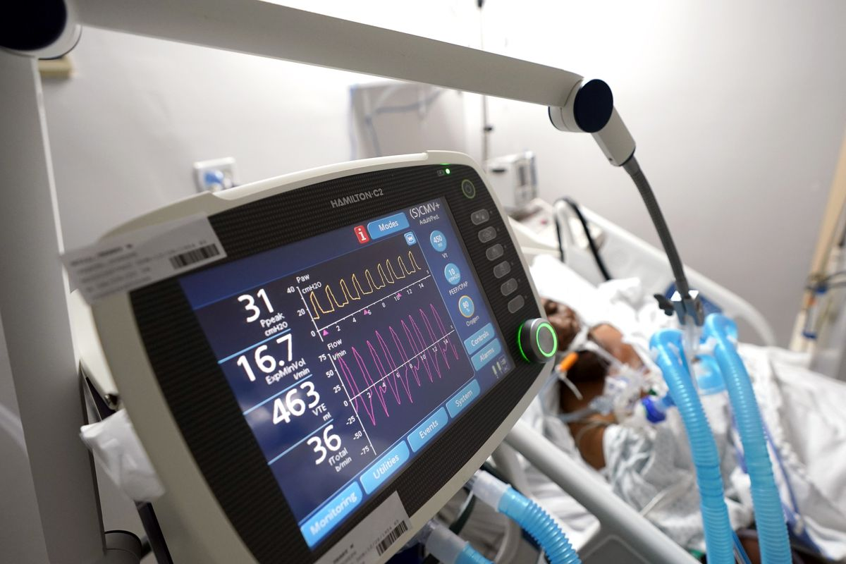 In this July 6, 2020, file photo, a ventilator helps a COVID-19 patient breath inside the Coronavirus Unit in a Houston hospital. Hospital data related to the coronavirus pandemic in the U.S. will now be collected by a private technology firm, rather than the Centers for Disease Control and Prevention — a move the Trump administration says will speed up reporting but one that concerns some public health leaders