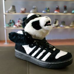 """If we had $365 and size 7.5 feet, we'd take this <a href=""""http://p4pshoes.com/products/jeremy-scott-panda"""">Jeremy Scott x Adidas</a> fuzzy panda pair."""