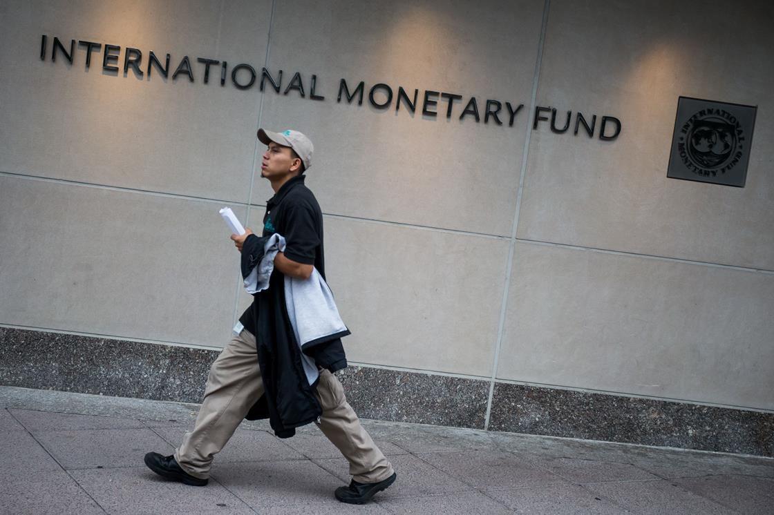 Man walking by IMF building