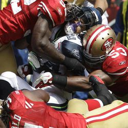 FILE - In this Sept. 11, 2011 file photo, San Francisco 49ers linebackers Patrick Willis (52),backer NaVorro Bowman (53), and defensive tackle Ray McDonald (91) tackling Seattle Seahawks running back Marshawn Lynch (24) during the first quarter of an NFL football game in San Francisco. They are not only the biggest reason behind the 49ers' defensive success, they are a close bunch that has quickly become the new NFL standard for linebackers. Meet Patrick Willis, NaVorro Bowman, Aldon Smith and Ahmad Brooks.