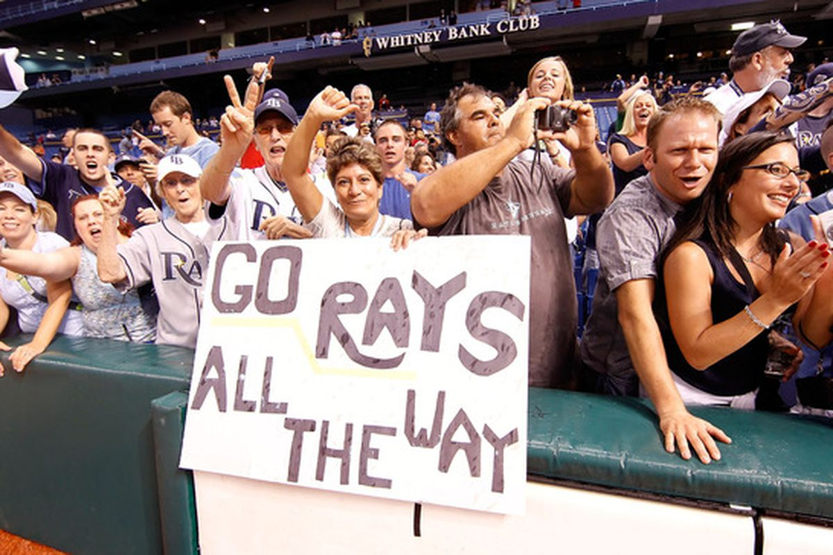 ST. PETERSBURG - SEPTEMBER 28:  Fans of the Tampa Bay Rays celebrate after the Rays clinch a playoff birth against the Baltimore Orioles at Tropicana Field on September 28 2010 in St. Petersburg Florida.  (Photo by J. Meric/Getty Images)