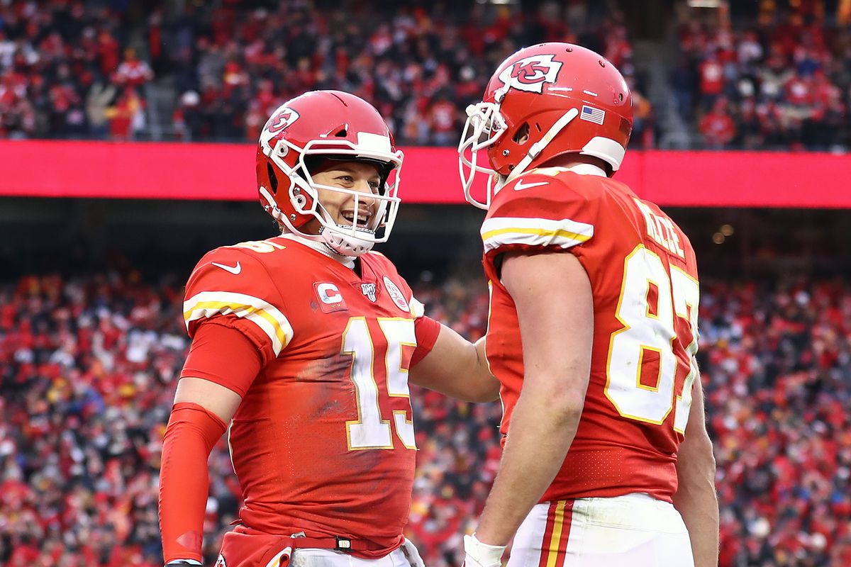 Patrick Mahomes of the Kansas City Chiefs is congratulated by his teammate Travis Kelce after a third quarter touchdown against the Houston Texans in the AFC Divisional playoff game at Arrowhead Stadium on January 12, 2020 in Kansas City, Missouri.