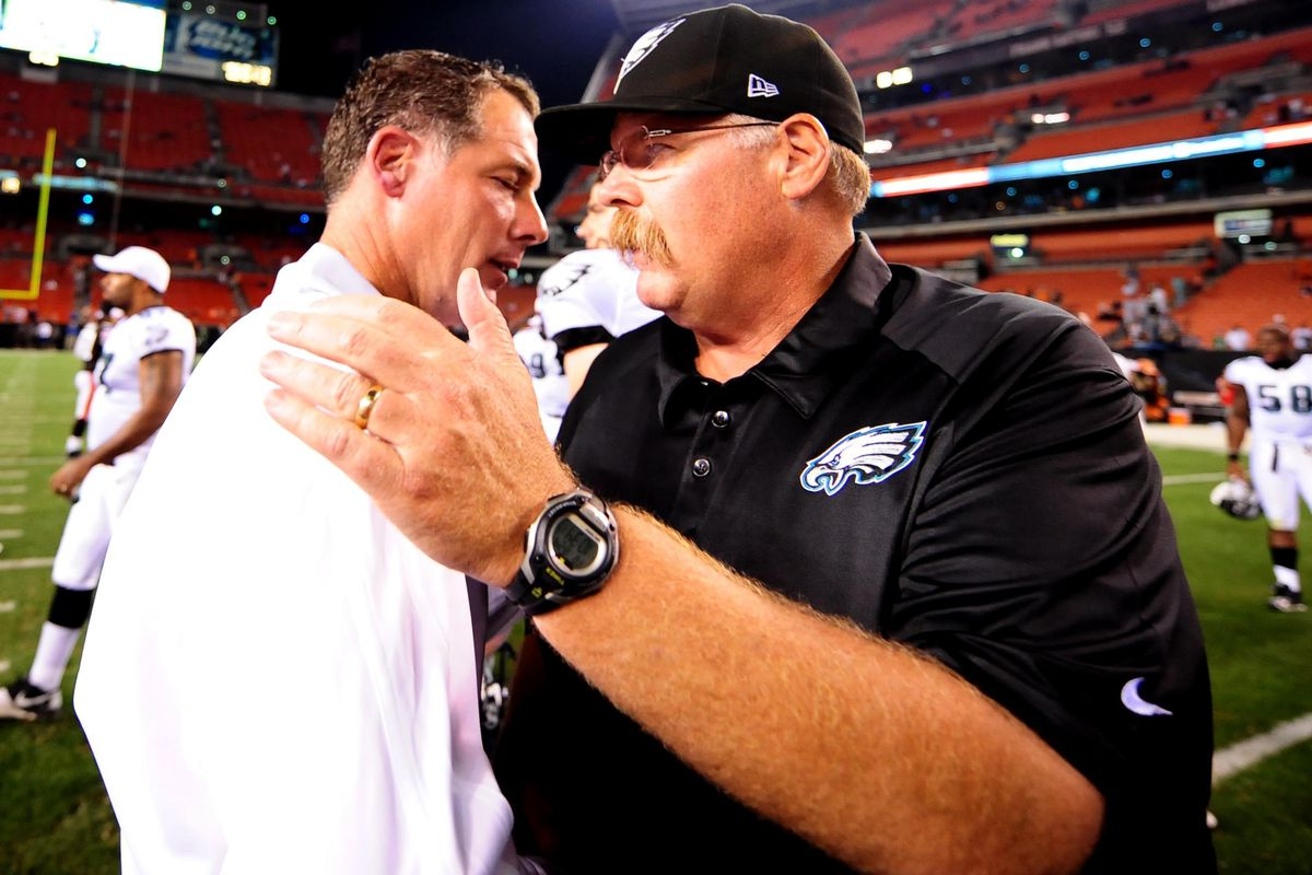 Aug 24, 2012; Cleveland, OH, USA; Cleveland Browns head coach Pat Shurmur (left) shakes hands with Philadelphia Eagles head coach Andy Reid at the end of the preseason game at Cleveland Browns Stadium. Mandatory Credit: Andrew Weber-US Presswire