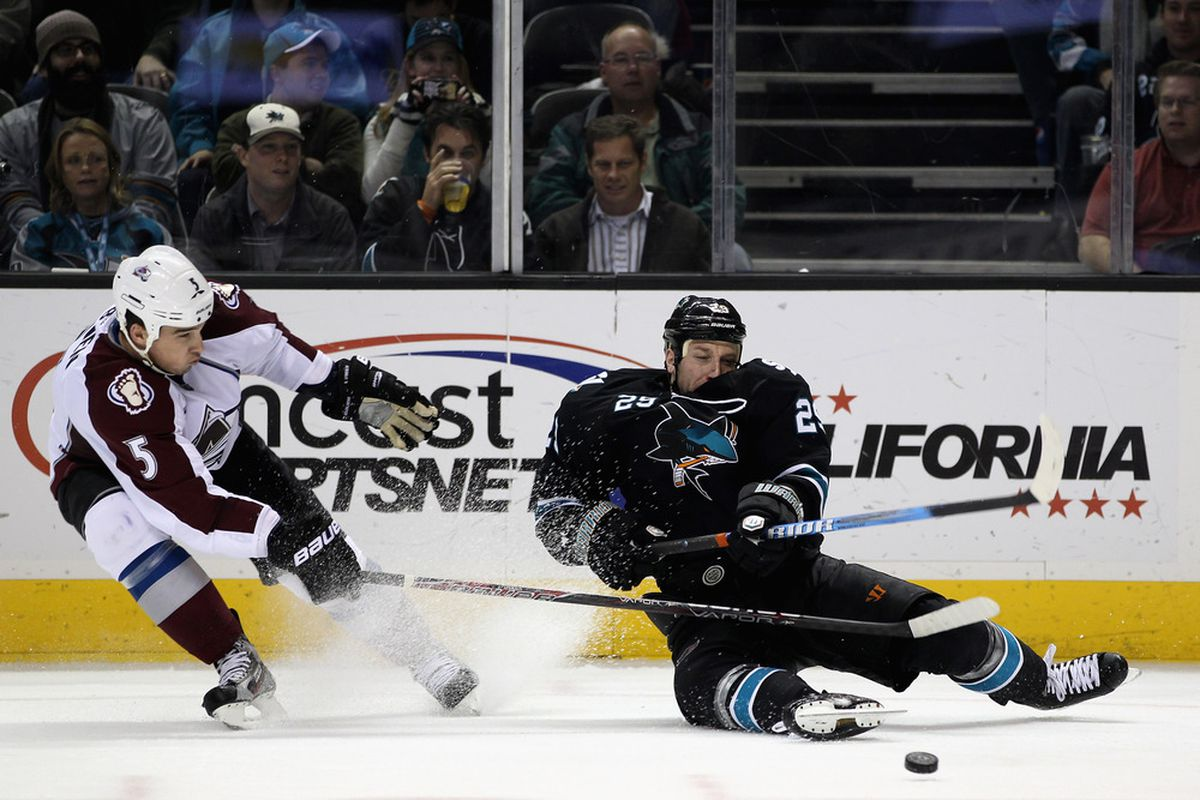 SAN JOSE, CA - DECEMBER 15:  Shane O'Brien #5 of the Colorado Avalanche and Ryane Clowe #29 of the San Jose Sharks go for the puck at HP Pavilion at San Jose on December 15, 2011 in San Jose, California.  (Photo by Ezra Shaw/Getty Images)
