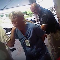 In this July 26, 2017, frame grab from video taken from a police body camera and provided by attorney Karra Porter, nurse Alex Wubbels is arrested by a Salt Lake City police officer at University Hospital in Salt Lake City. The Utah police department is making changes after the officer dragged Wubbels out of the hospital in handcuffs when she refused to allow blood to be drawn from an unconscious patient.