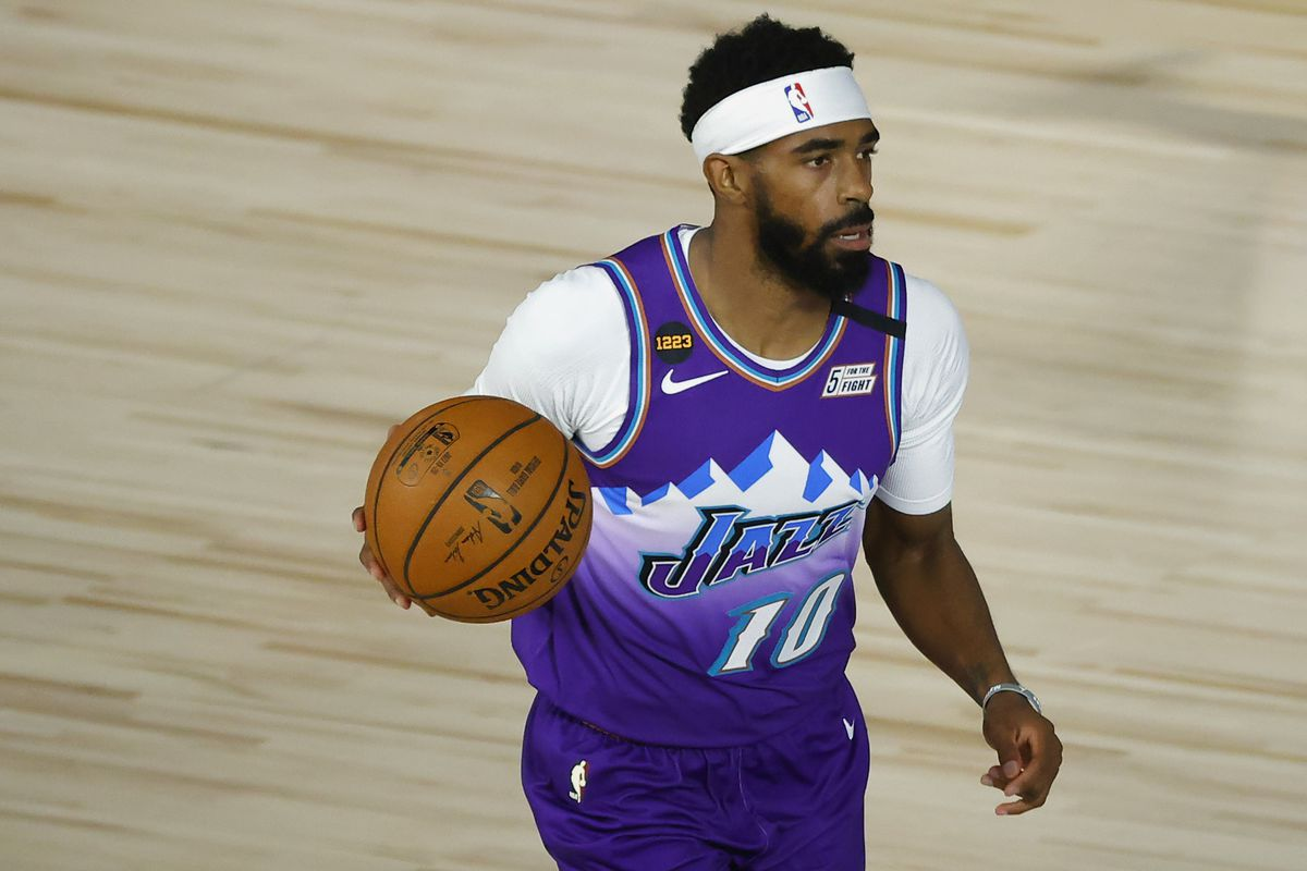 Mike Conley of the Utah Jazz dribbles the ball against the Memphis Grizzlies during the first half at HP Field House at ESPN Wide World Of Sports Complex on August 5, 2020 in Lake Buena Vista, Florida.