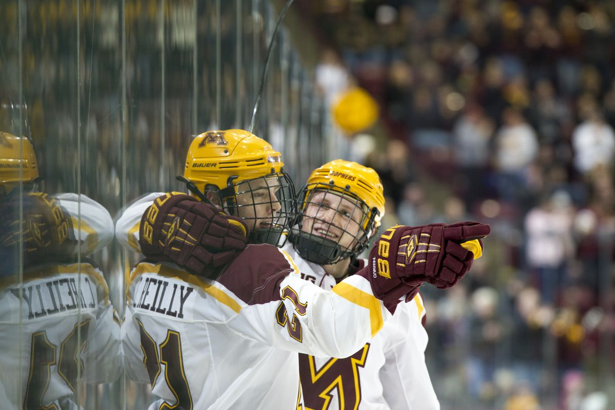 Connor Reilly (21) celebrating a goal with defenseman Michael Brodzinski (20)