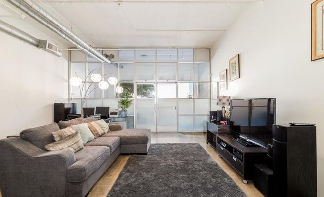 Living room leading to balcony
