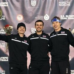 From left to right, second-place Tucker Fredricks, winner Mitchell Whitmore and third-place Brian Hansen celebrate on the podium following the men's 500 meters during the U.S. Olympic speedskating trials Saturday, Dec. 28, 2013, in Kearns, Utah. (AP Photo/Rick Bowmer)
