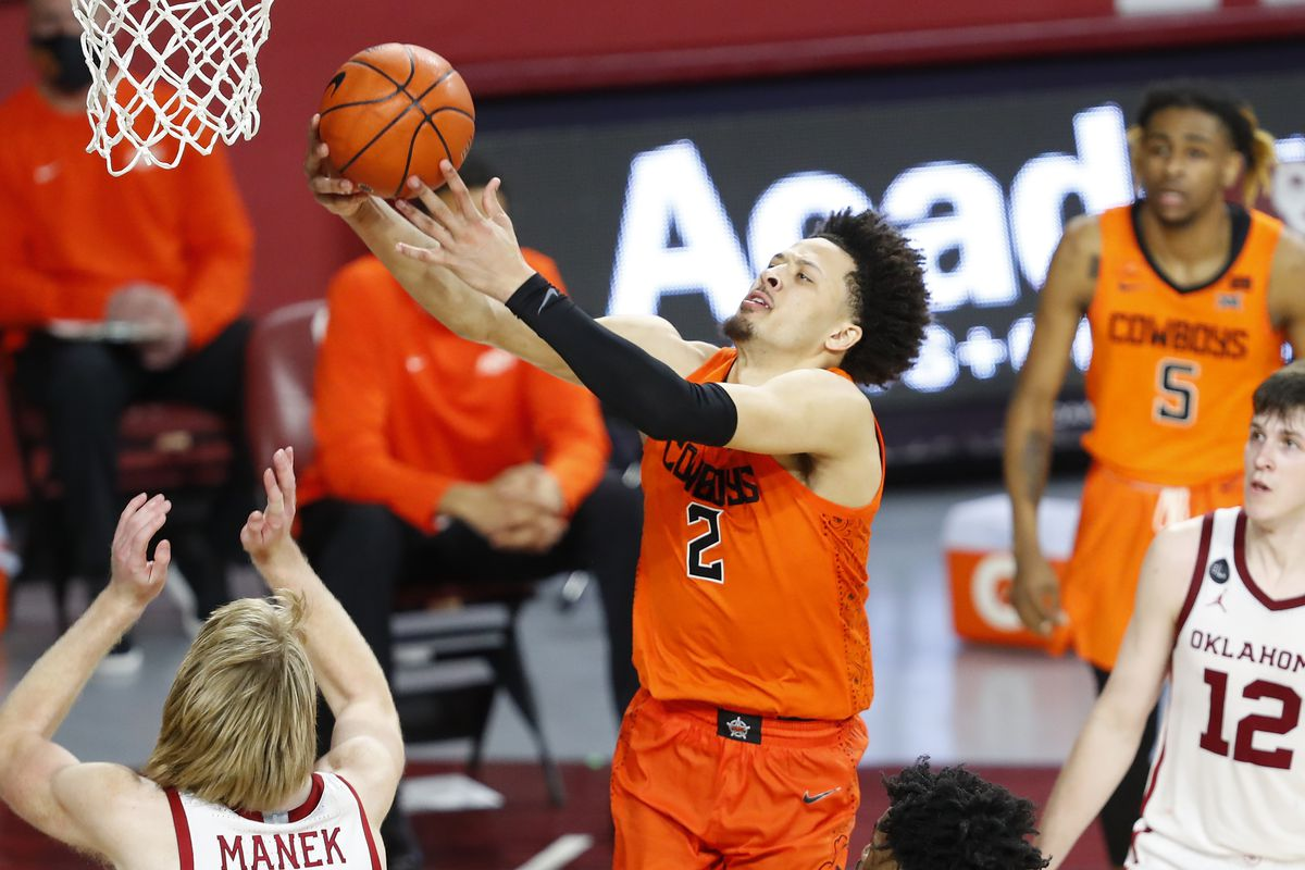 Oklahoma State Cowboys guard Cade Cunningham goes to the basket in front of Oklahoma Sooners forward Brady Manek in overtime at Lloyd Noble Center. Oklahoma State won 94-90.