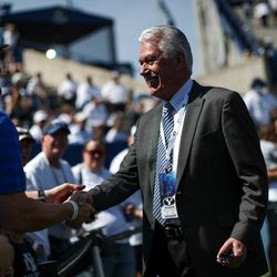 Dieter F. Uchtdorf, third counselor to the First Presidency of the Church of Jesus Christ of Latter-day Saints, greets fans before the game between the Brigham Young Cougars and the Wisconsin Badgers at LaVell Edwards Stadium in Provo on Saturday, Sept. 16, 2017.