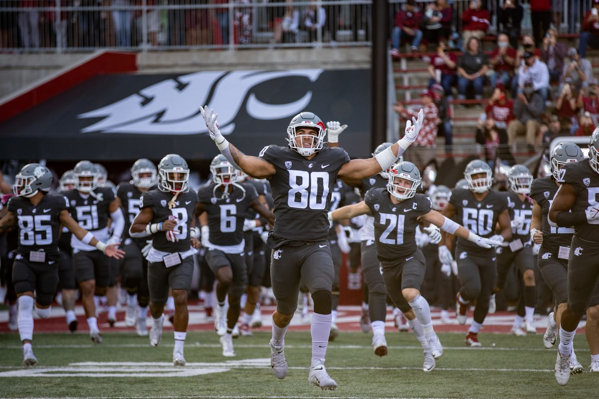 PULLMAN, WA - OCTOBER 16: Washington State EDGE Brennan Jackson (80) runs out of the tunnel prior to a PAC 12 conference matchup between the Stanford Cardinal and the Washington State Cougars on October 16, 2021, at Martin Stadium in Pullman, WA.