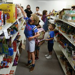 Students tour the Mill Creek Elementary Food Pantry & Resource Center during its grand opening at the Millcreek school on Thursday, Sept. 17 2020.