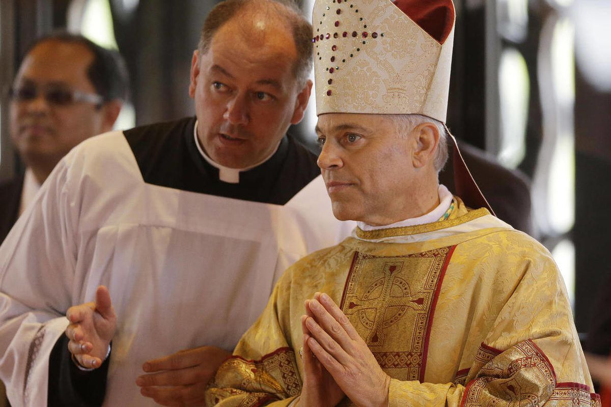 Salvatore J. Cordileone, right, waits to be introduced during a ceremony to install him as the new archbishop of San Francisco at the Cathedral of St. Mary of the Assumption in San Francisco, Thursday,  Oct. 4, 2012.