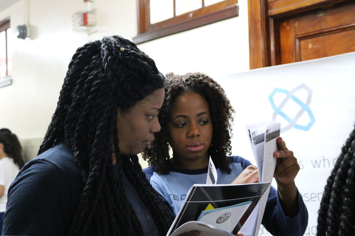 Yvonne Williams (r), the school business manager at Academy for Software Engineering, at the citywide high school fair.