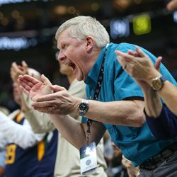 Utah Jazz fans cheer during the game against the Golden State Warriors at Vivint Arena in Salt Lake City on Tuesday, April 10, 2018.
