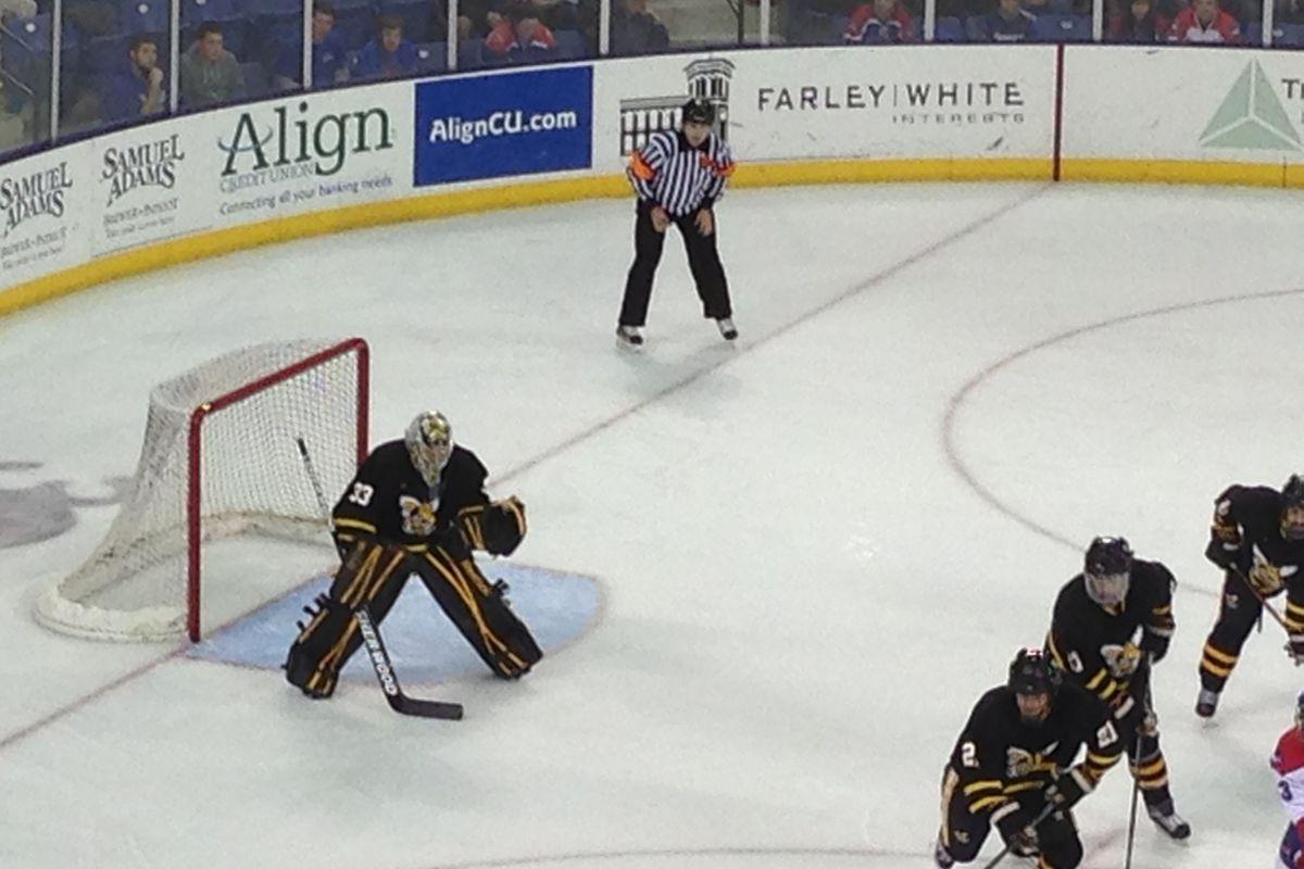 American International freshman goaltender Ty Reichenbach readies for a face-off against UMass-Lowell.