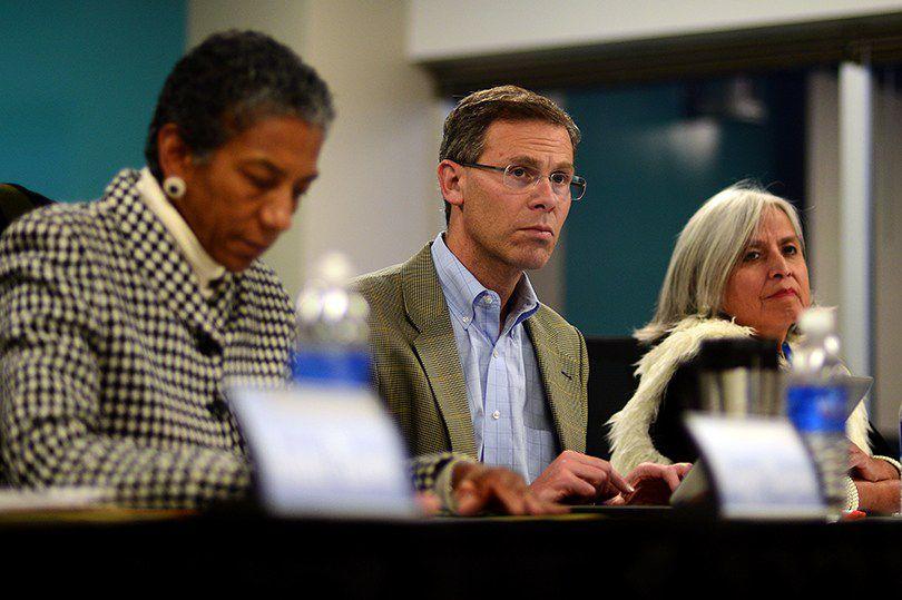 Boasberg sits in a meeting with school board members in 2017.