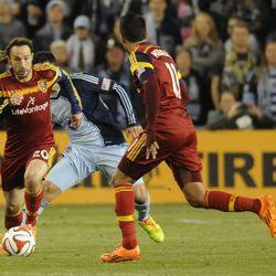 Real Salt Lake's Ned Grabavoy races past the Sporting KC defense during a game at Sporting Park in Kansas City, Kan., on Saturday, April 5, 2014.