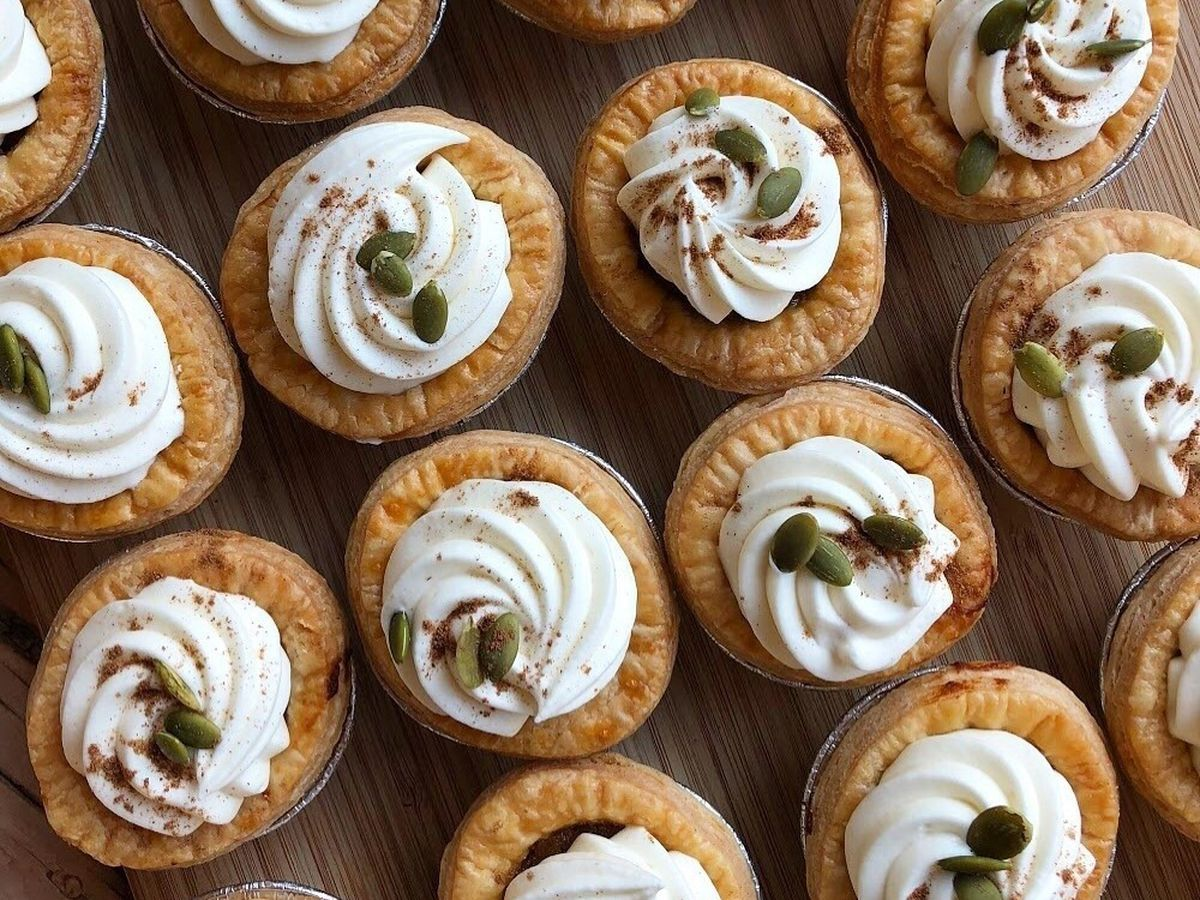 mini pies with swirl of whipped cream on top