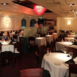 Caffe Abbracci's dining room brings elegance as a long-standing institution of Coral Gables and its hand-blown Venetian glass chandelier is unmistakable.