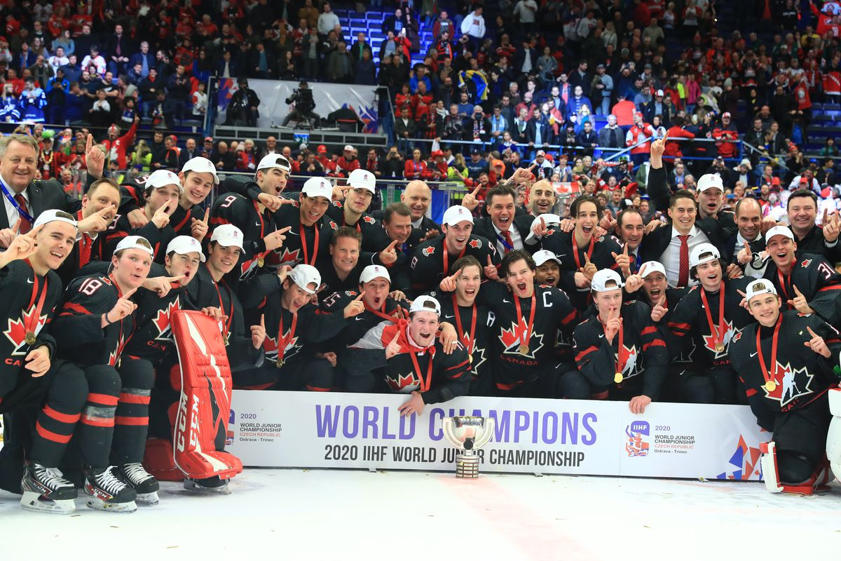 Canadian players and coaching staff pose for a group photograph during the medal ceremony for the 2020 World Junior Ice Hockey Championship final match between Canada and Russia at Ostravar Arena; Canada won 4-3.