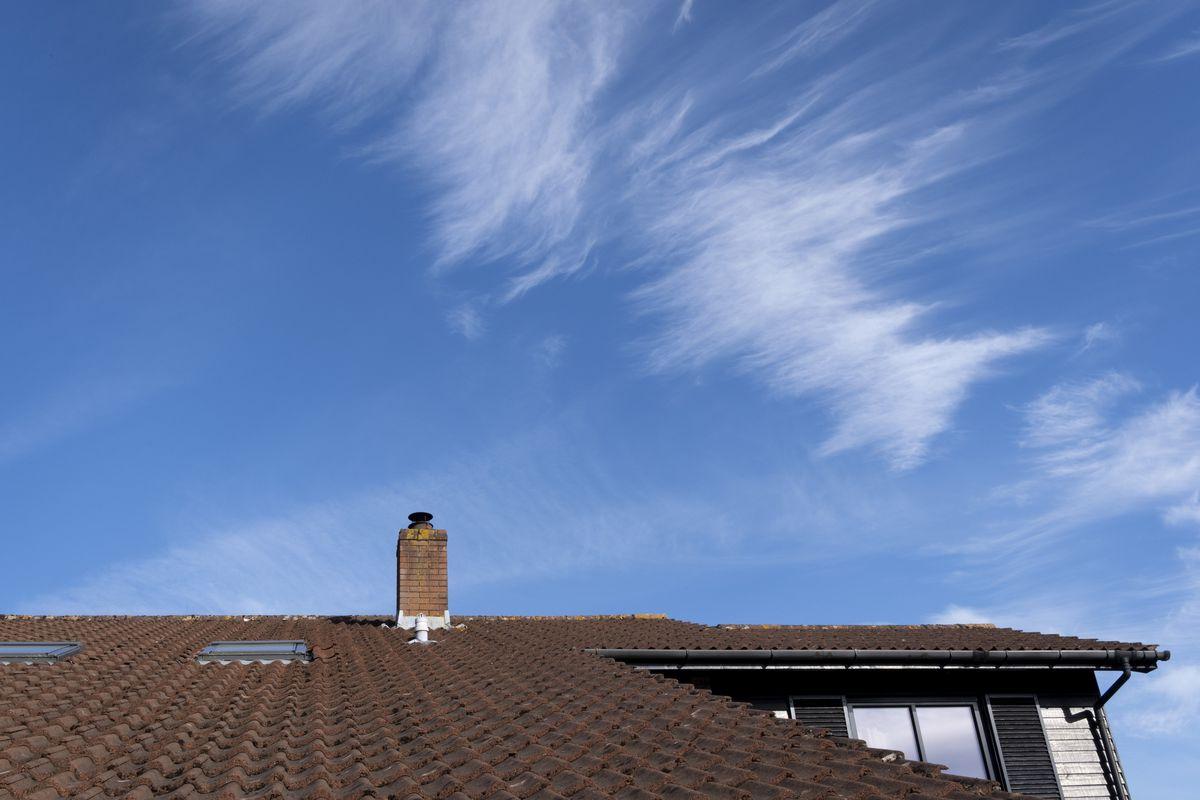 House Chimney Beneath Blue Skies