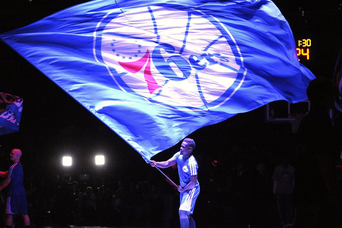 We've got a man on the inside, giving us the goods on the Sixers. No, it's not the man holding the flag in this photo.