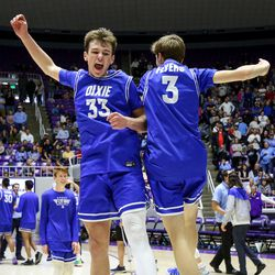 Dixie's Jeff Cox (33) and Carson Forsey (3) celebrate winning the 4A boys championship basketball title at the Dee Events Center in Ogden on Saturday, Feb. 29, 2020.