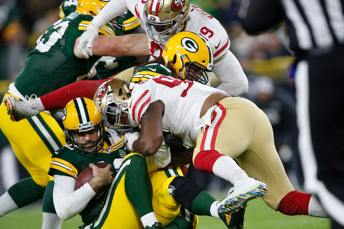 Ronald Blair III of the San Francisco 49ers sacks Aaron Rogers of the Green Bay Packers during the game at Lambeau Field on October 15, 2018 in Green Bay, Wisconsin.