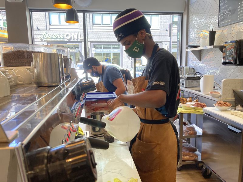 Davion Lyons makes a drink for a customer at Cannelle by Matt Knio in Detroit. Downtown businesses such as Cannelle that once took for granted an office-worker clientele have had to adapt as offices remain closed and workers stay home.